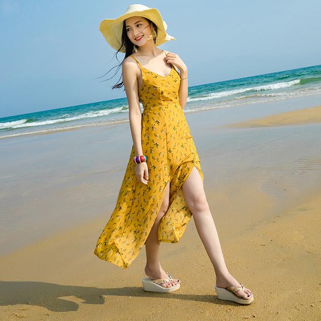 ชุดเดรสยาวเที่ยวทะเลสีเหลือง พิมพ์ลายสวยๆ สายเดี่ยว ผูกหลัง