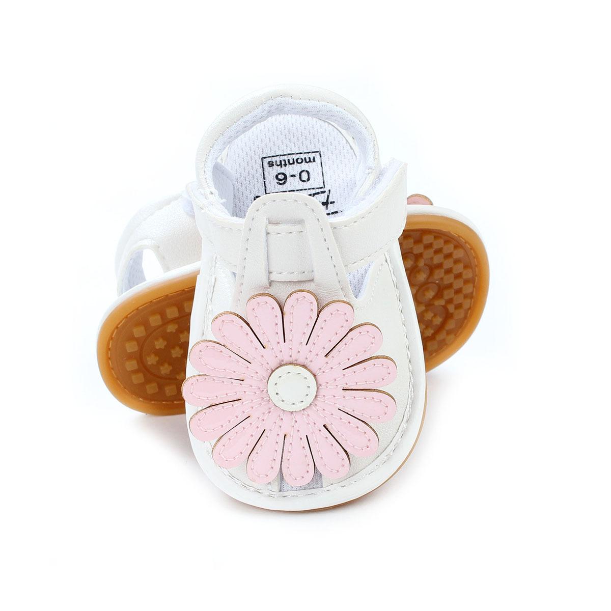 รองเท้าเด็กอ่อน 0-12เดือน สีขาว ติดดอกไม้ตรงกลางสีชมพูหนึ่งดอก